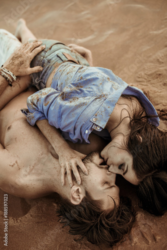 Foto op Aluminium Artist KB Sensual couple laying on the tropical sand