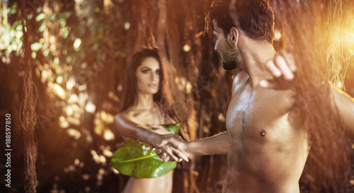 Poster Artist KB Portrait of two nude lovers walking among tropical trees