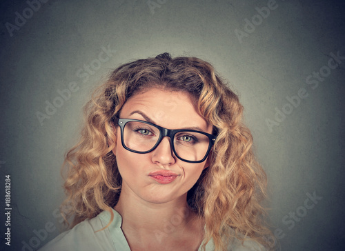 Fotografija  Annoyed young woman looking skeptic