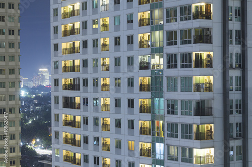 Residential apartment windows at night for electrical and power energy concept Canvas Print