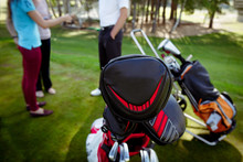 Clubs In Cases In Bag On Pull ...