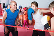 Sportsman at boxing workout with instructor