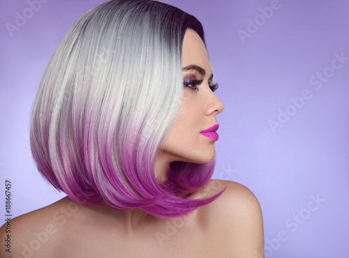 Fototapety, obrazy: Colorful dyed Ombre hair extensions. Fashion haircut. Beauty Model Girl blonde with short bob purple hairstyle isolated on purple background. Closeup woman portrait.