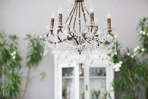 Photo Crystal chandelier in room interior