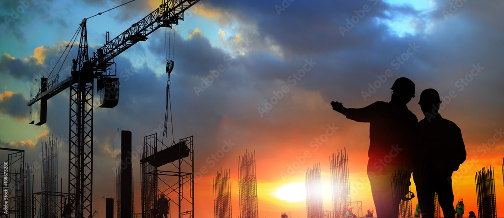 Fototapety, obrazy: two engineer on working site , engineer and tower cranes at construction site and city background