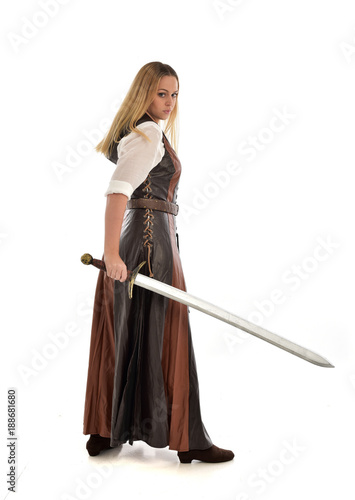 Full Length Portrait Of Girl Wearing Brown Fantasy Costume Holding A Sword Standing Pose On White Studio Background Buy This Stock Photo And Explore Similar Images At Adobe Stock Adobe Stock