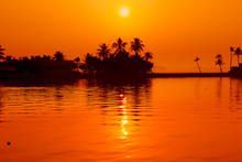 Sunset Over Lake In Kerala Ind...