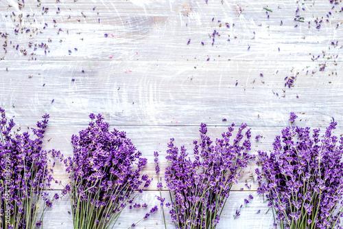 Bunch of dry lavender flowers on rustic background top view mock