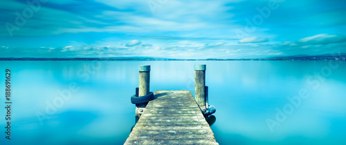 Printed kitchen splashbacks Blue Halftone color. Abstract landscape. Wooden pier on Lake Zug in Switzerland. Long exposure.