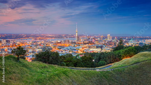 Wall Murals New Zealand Auckland. Cityscape image of Auckland skyline, New Zealand taken from Mt. Eden at sunset.