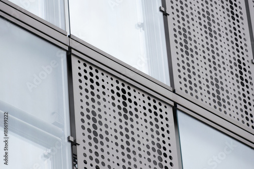 Fotografija  Modern building facade with perforated metal shading and glass