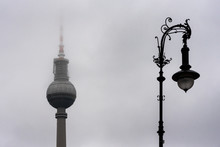 Old And New Berlin TV Tower (Fernsehturm) Nd A Street Lamp In Deep Fog - Landmark Of Germany Capital