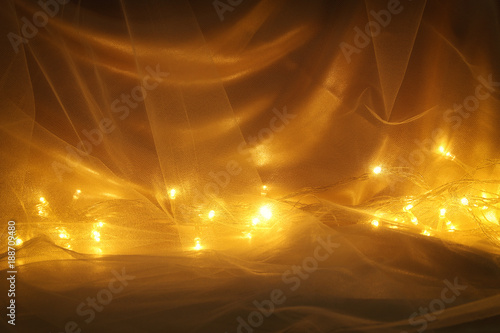 Fotografie, Obraz  Abstract chiffon texture background with festive gold lights.