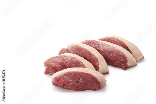Raw duck breast pieces with skin isolated on white background
