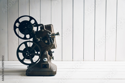 Film projector on a white wooden background