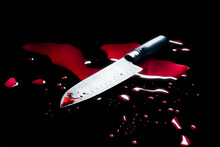 Bloody Knife Isolated On Black...