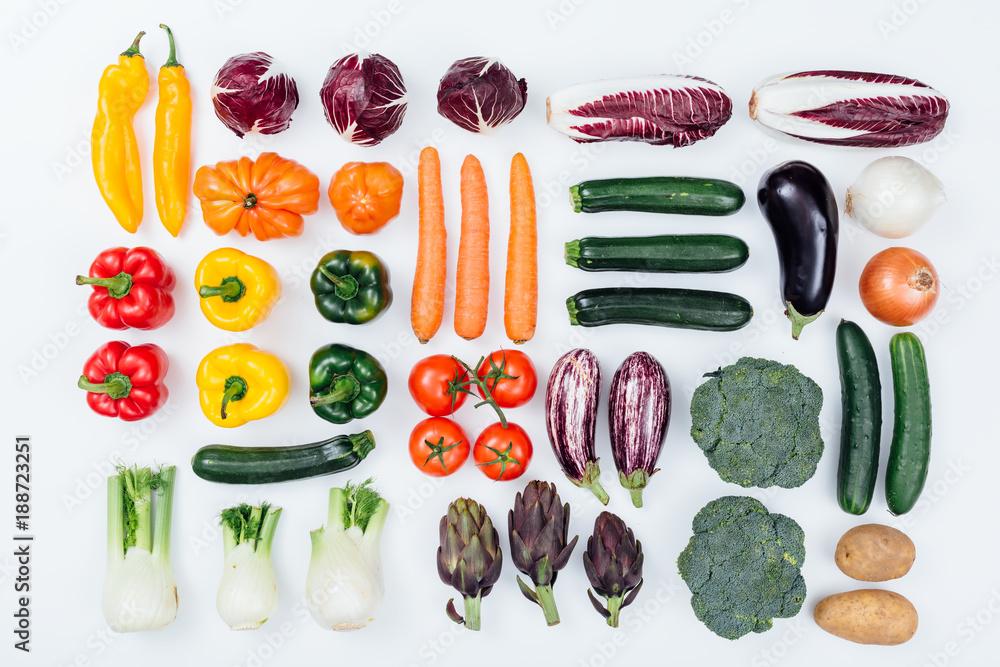 Fresh tasty vegetables on white background