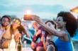 canvas print picture - Happy friends taking selfie with smartphone at beach party outdoor - Young people having fun at kiosk bar drinking champagne - Youth lifestyle and vacation concept