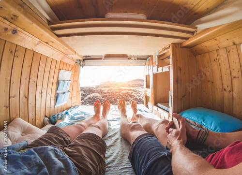 Obraz na plátně  Legs view of happy couple inside minivan