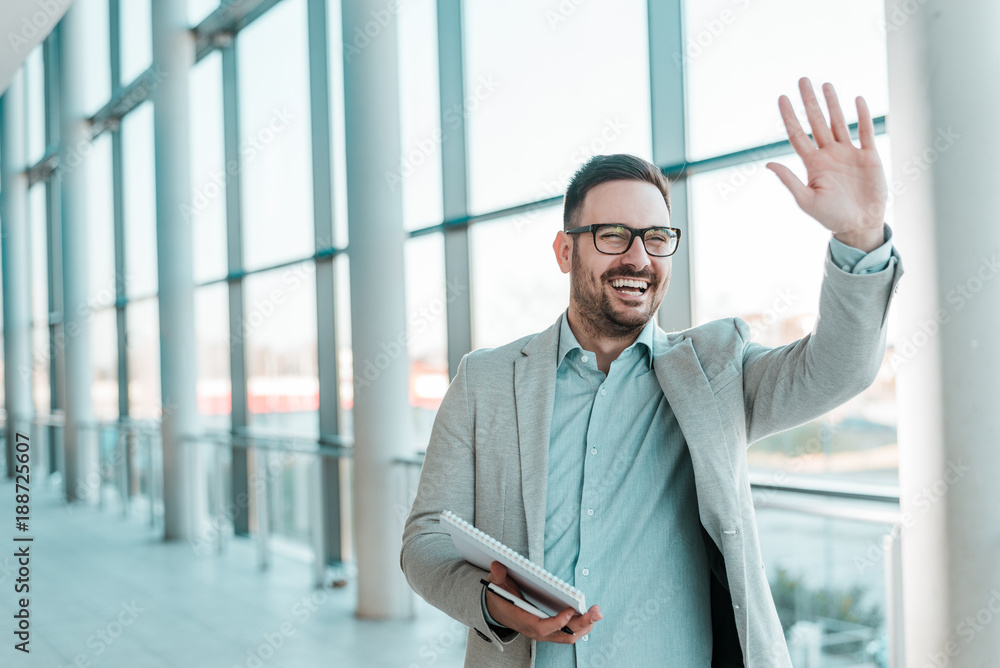 Fototapety, obrazy: Handsome smiling bearded businessman is waving.