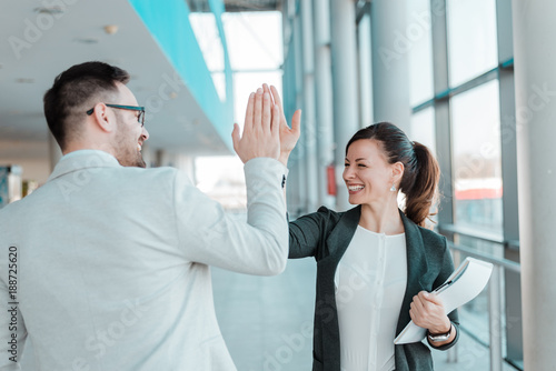 Photographie  Two business people high-five. Job well done.