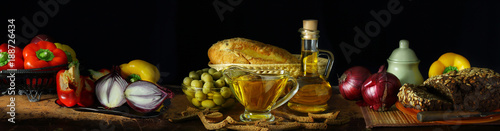 Panorama still life with olive oil and vegetables