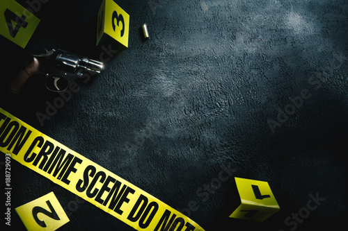 Fotomural  Crime scene concept with a gun and evidence markers , high contrast image