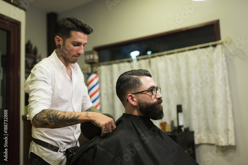 Staande foto Kapsalon Modern hairdresser in barber shop preparing man for haircut