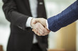 concept of a reliable partnership : a handshake of business partners