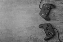Video Game Controllers On Grey...