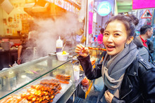 Asian Young Womanl Eating Gril...