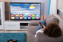 Woman Watching Television With...