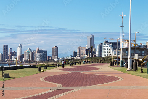 Paved Promenade Against City Skyline in Durban South Africa Canvas Print