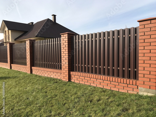 Foto  Brown metallic corrugated fence