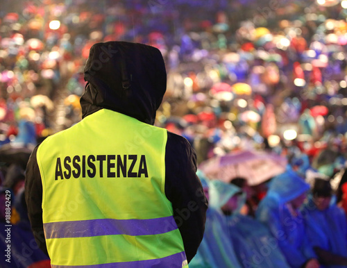 italian security guard during the event with text ASSISTENZA that means Assitance in Italian language