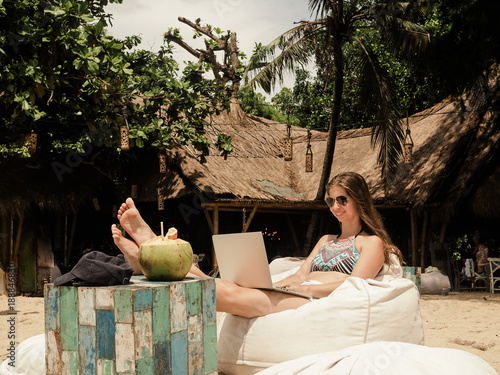 digital nomad working on the beach with laptop Fototapeta