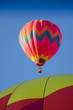 Hot Pink Hot Air Balloon in a Clear Blue Sky