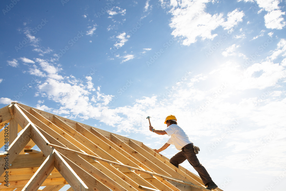 Fototapety, obrazy: roofer carpenter working on roof structure on building site