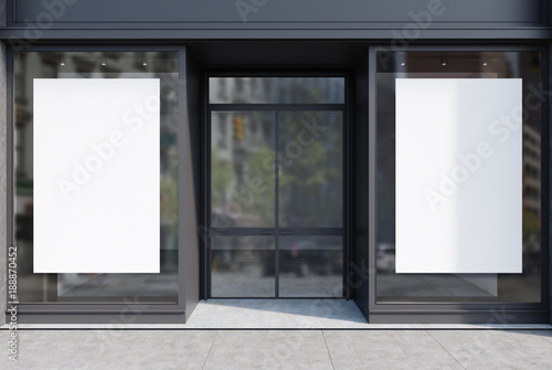 Dark gray cafe facade, two posters