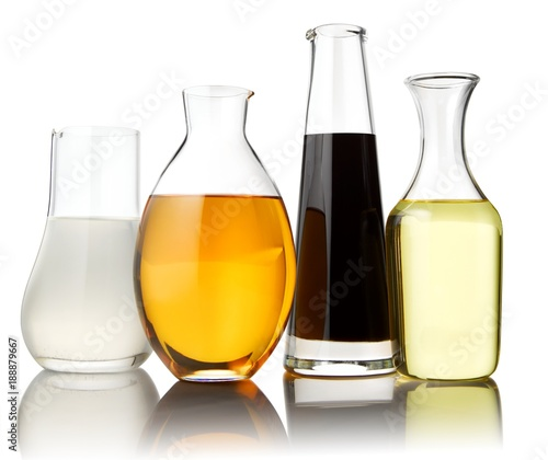 Tuinposter Alcohol Four glass carafes with drinks on white background