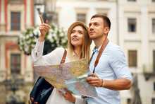 Couple With Map On Travel Vaca...