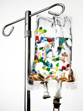 IV Drip Bag With Colorful Pills In Clear Liquid