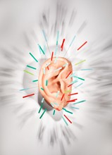 Acupuncture Needles Stuck In Ear Studio Shot