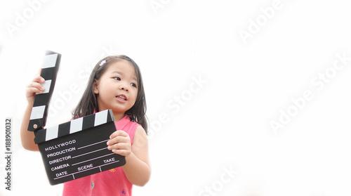 Little asian girl hands holding clapper board for making video cinema in studio Wallpaper Mural
