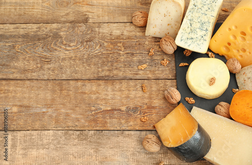 Fototapeta Variety of cheese on wooden background obraz