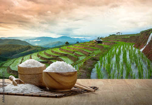 Fotografie, Obraz  Jasmine rice and steamed rice in wooden bowl with the chopsticks on the wooden t