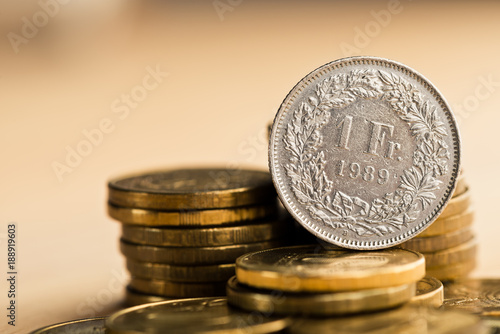Fotografie, Obraz one swiss frank coin and gold money on the desk