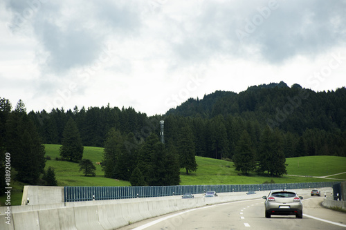 Deurstickers Oude auto s Travelers people driving car on the highway road go to Tirol city in Austria passed at Ulm city in Stuttgart, Germany
