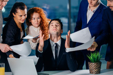 Stressed Male Worker Raises Hi...