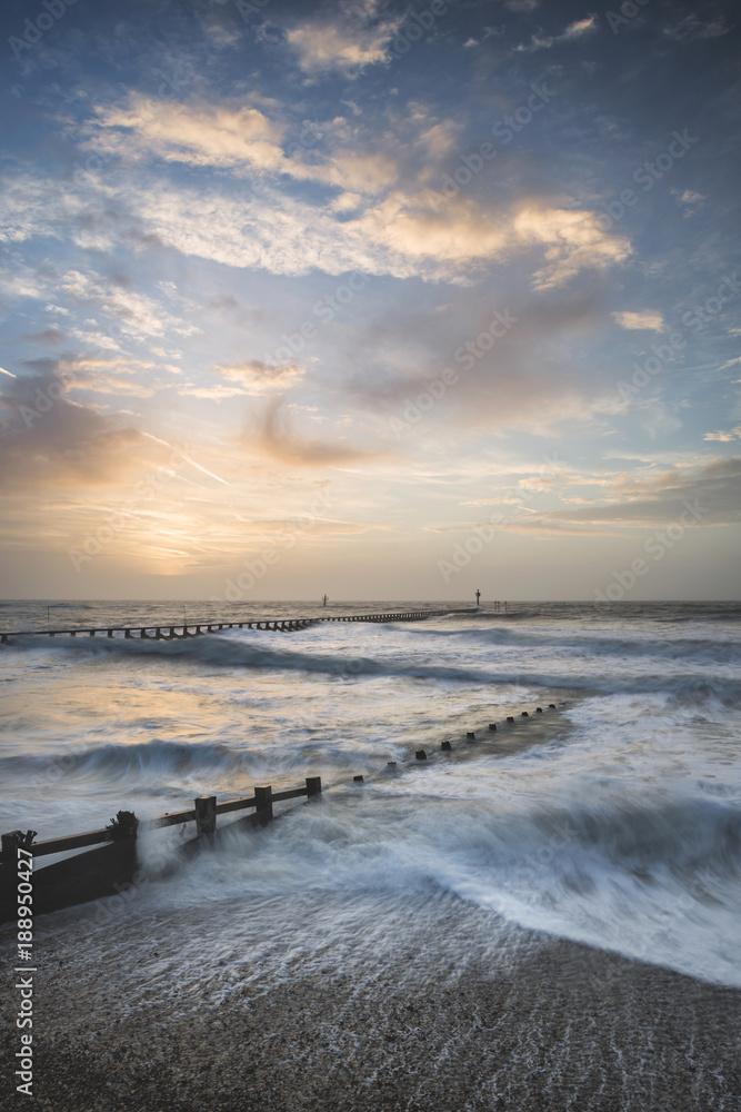 Fototapety, obrazy: Beautiful dramatic stormy landscape image of waves crashing onto beach at sunrise